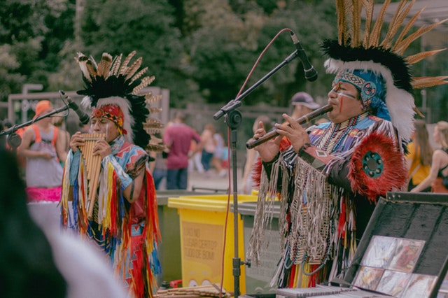 photo-of-two-native-americans-playing-woodwind-instruments-2539269