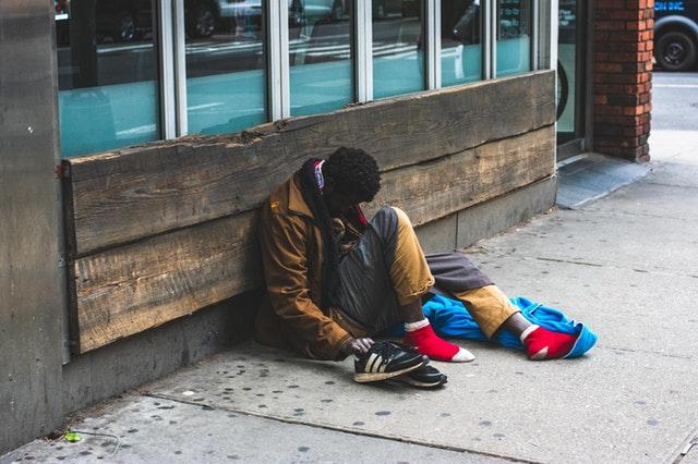 man-sitting-on-street-2239908