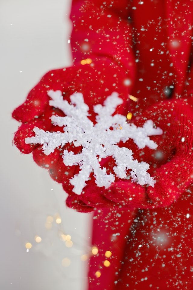 person-holding-a-snowflake-3264658