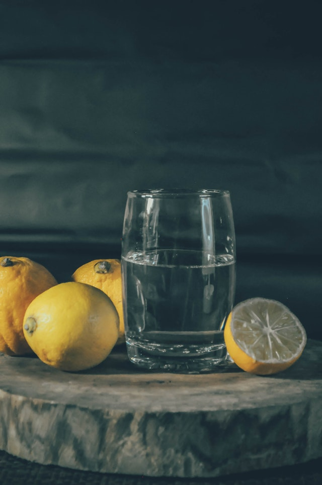 photo-of-drinking-glass-beside-lemons-2064437